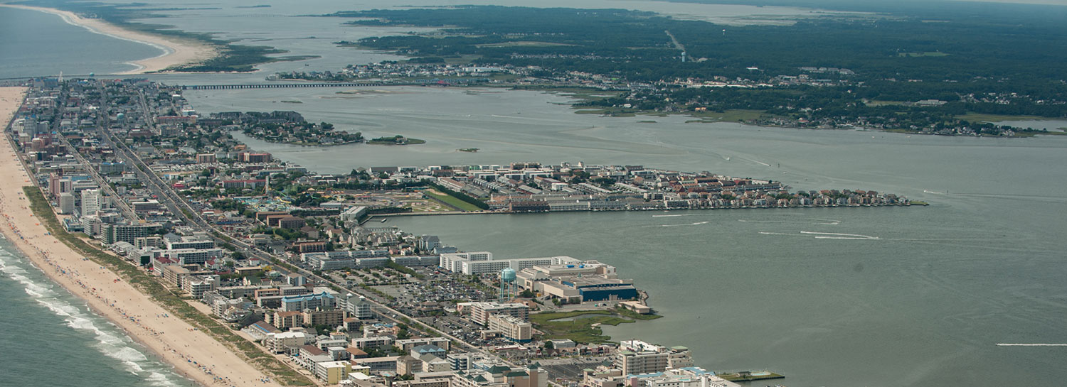 Aerial view of Ocean City, Atlantic ocean beach, and Assawoman Bay