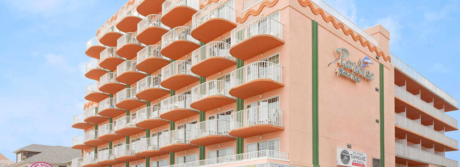 Exterior angled view of Paradise Plaza Inn showing many rooms with balconies